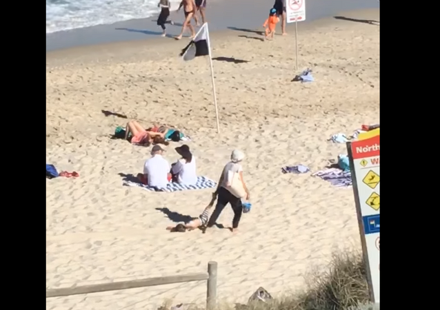 No Negotiations: Australian Woman Drags Seemingly Content Child Through Sand