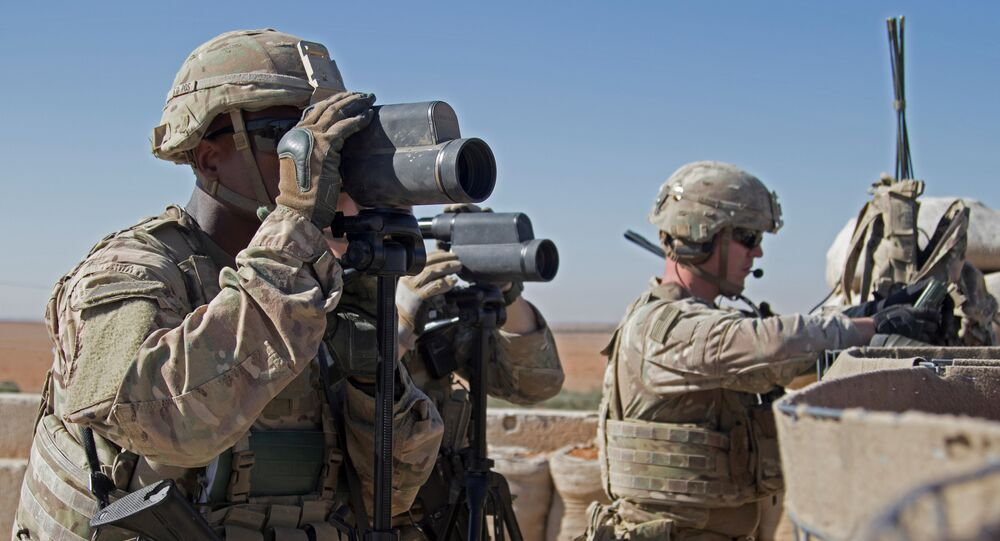 U.S. Soldiers surveil the area during a combined joint patrol in Manbij, Syria, November 1, 2018. Picture taken November 1, 2018
