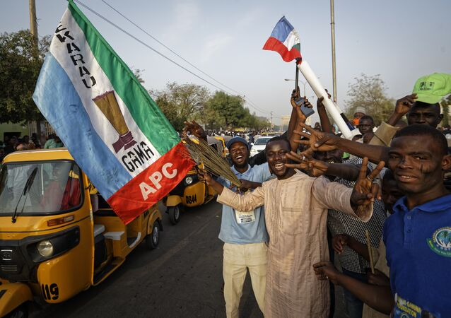 Supporters of President Buhari's ruling APC party celebrate results from the Nigerian elections on 25 February 2019