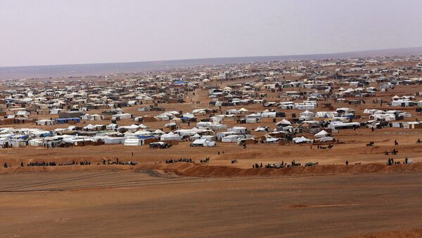 This picture taken Tuesday, Feb. 14, 2017, shows an ariel view of the informal Rukban camp, between the Jordan and Syria borders. - Sputnik International