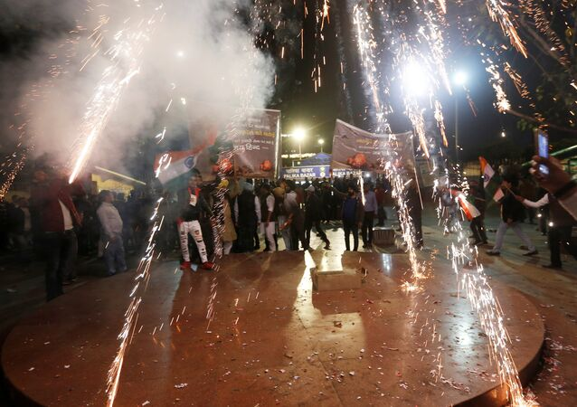 People burn firecrackers to celebrate after Indian authorities said their jets conducted air strikes on militant camps in Pakistani territory, in New Delhi, India, February 26, 2019