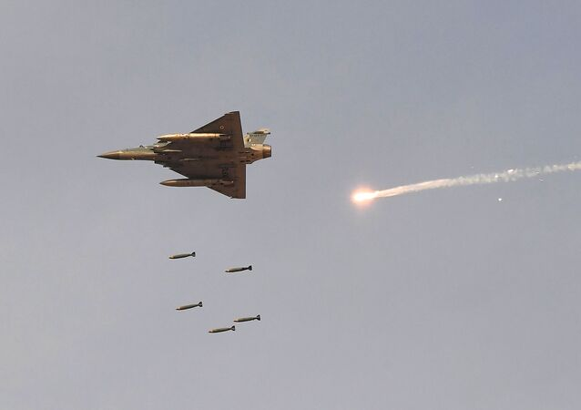 In this photo taken on February 16, 2019, an Indian Air Force (IAF) Mirage-2000 fighter aircraft drops bombs during the 'Vayu Shakti 2019' fire power demonstration at the IAF's firing range field in Pokhran in the state of Rajasthan