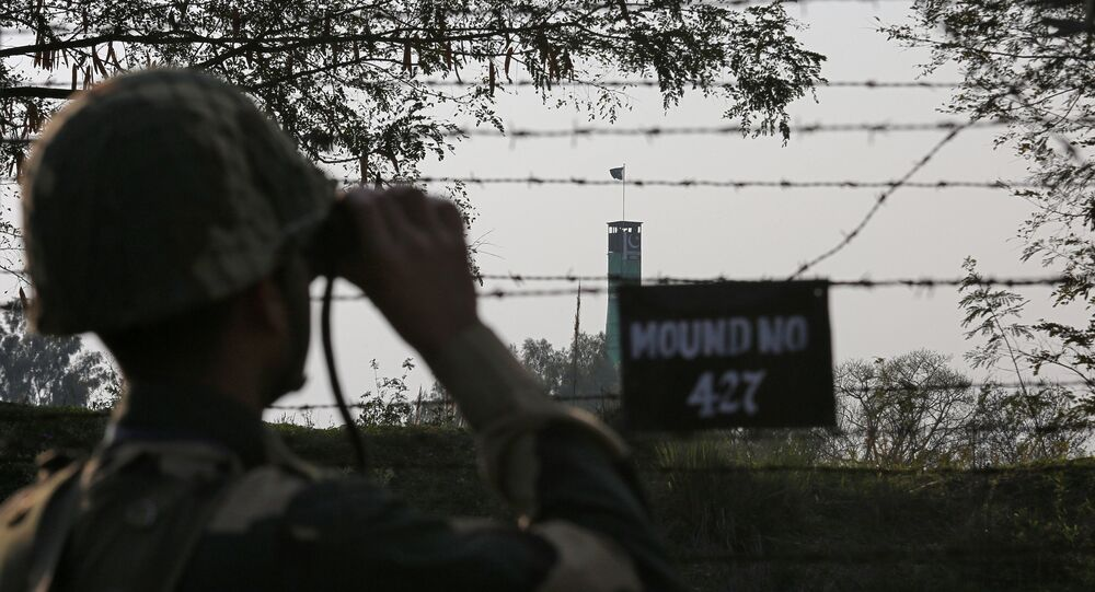 An India's Border Security Force (BSF) soldier keeps vigil during patrol along the fenced border with Pakistan in Ranbir Singh Pura sector near Jammu February 26, 2019