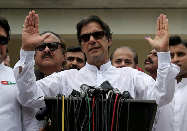 Cricket star-turned-politician Imran Khan, chairman of Pakistan Tehreek-e-Insaf (PTI), speaks after voting in the general election in Islamabad, July 25, 2018