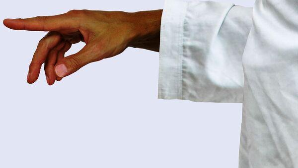 A person wearing a white robe - Sputnik International