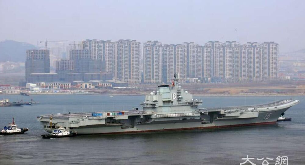 China's aircraft carrier Liaoning departs from the shipyards at Dalian, Liaoning, on February 24, 2019, following a six-month superstructure retrofit