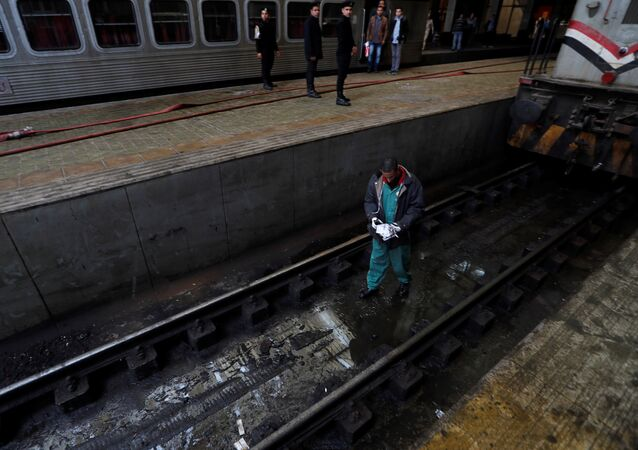 A rescue worker inspects the damage after a fire caused deaths and injuries at the main train station, in Cairo, Egypt, February 27, 2019.