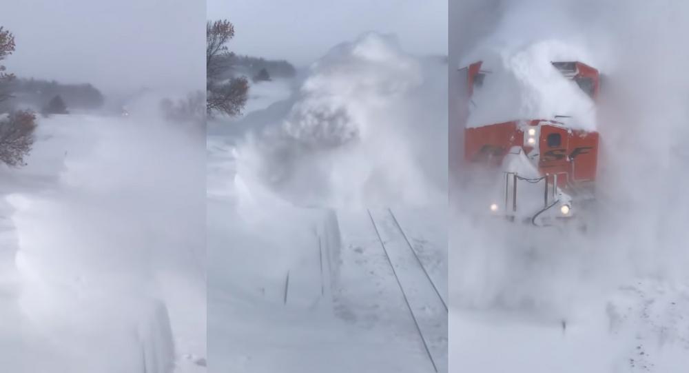 US Train Barrels Through Ground Blizzard