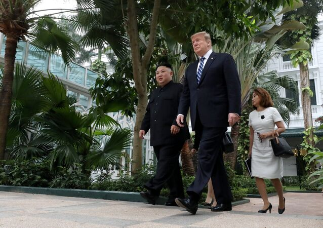 North Korea's leader Kim Jong Un and U.S. President Donald Trump walk in the garden of the Metropole hotel during the second North Korea-U.S. summit in Hanoi, Vietnam February 28, 2019