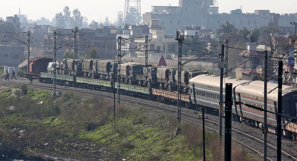 Indian army trucks are transported on a train near a railway station on the outskirts of Jammu February 28, 2019