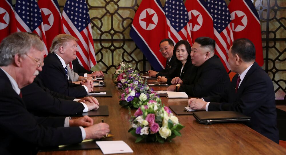 North Korea's leader Kim Jong Un speaks with U.S. President Donald Trump at the extended bilateral meeting in the Metropole hotel during the second North Korea-U.S. summit in Hanoi, Vietnam February 28, 2019