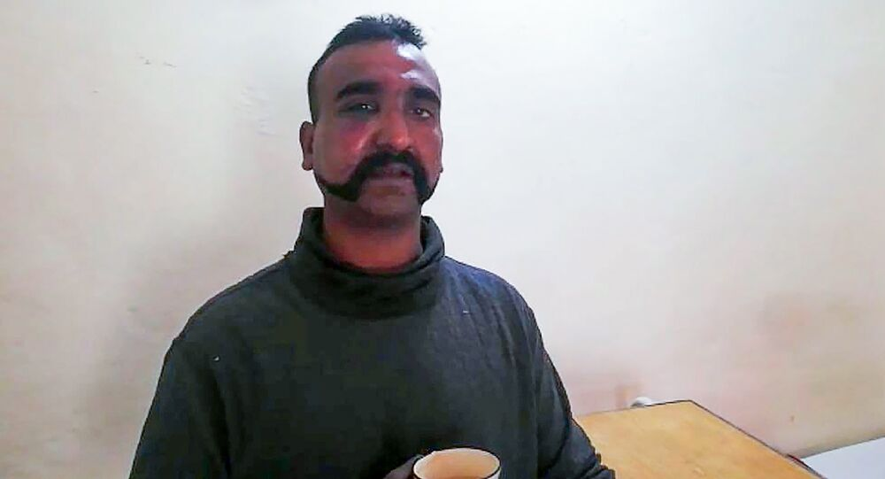 This handout photograph released by Pakistan's Inter Services Public Relations (ISPR) on February 27, 2019, shows captured Indian pilot looking on as holding a cup of tea in the custody of Pakistani forces in an undisclosed location