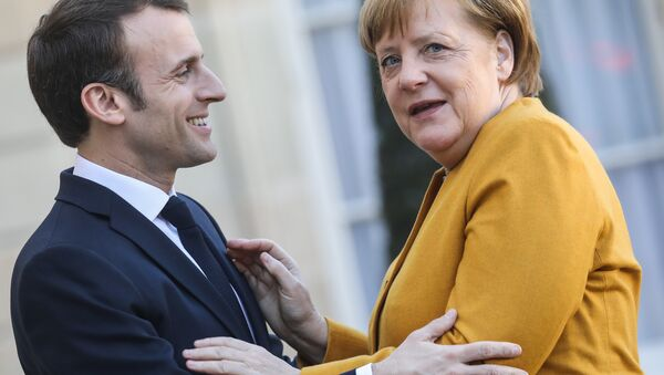 French President Emmanuel Macron (L) welcomes German Chancellor Angela Merkel as she arrives for a working meeting at the Elysee Palace on febuary 27, 2019, in Paris - Sputnik International