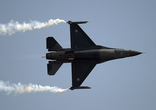 Pakistani F-16 fighter perform during a Pakistan Day military parade in Islamabad on March 23, 2018