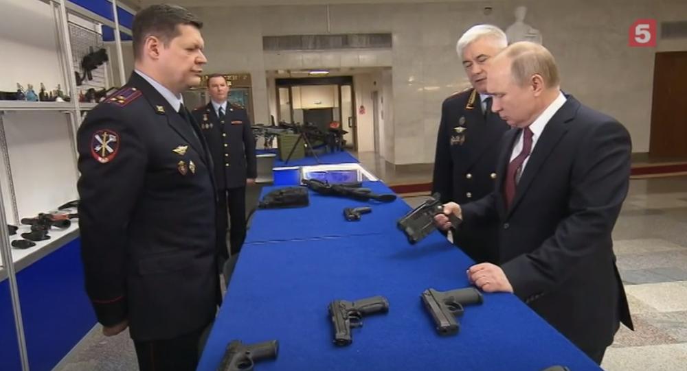 Putin checks out new Stun Gun for police use.