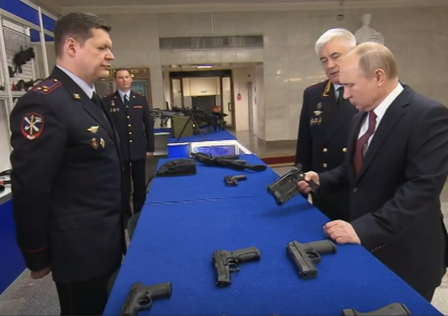 Putin checks out new Stun Gun for police use.