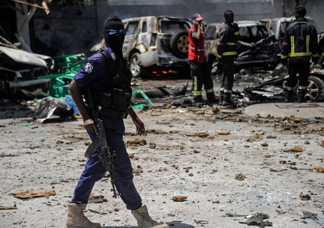 A Somali security personnel patrols at the scene where a car bomb exploded in Mogadishu, on January 29, 20 19
