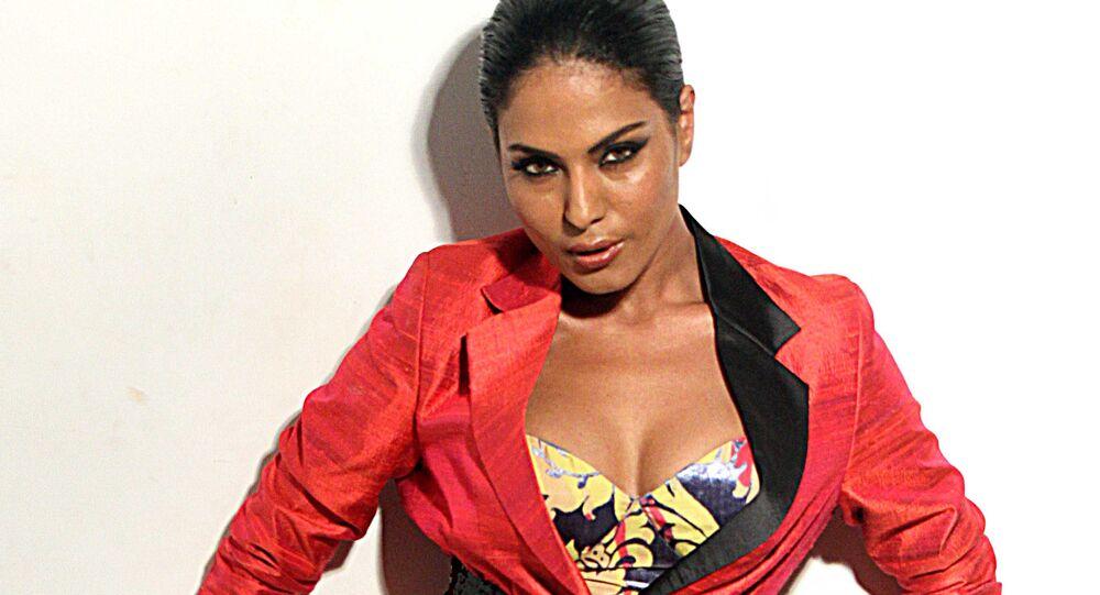 Pakistani actress Veena Malik poses during a promotional photo shoot in Mumbai on June 12, 2012