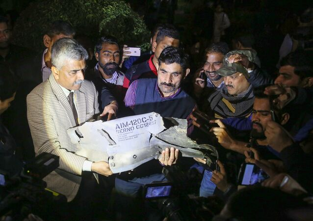 Indian Air Force officials show a section of an exploded AMRAAM missile, said to be fired by Pakistan Air Force (PAF) F-16, during a joint press conference of the Indian Air Force (IAF), Army and Navy in New Delhi on February 28, 2019
