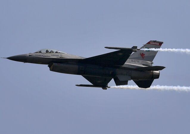 A Pakistani Air Force F-16 fighter jet flies during a military parade in Islamabad, Pakistan, Friday, March 23, 2018