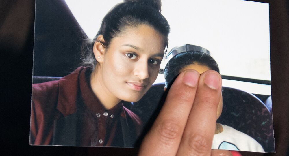 FILE PHOTO: Renu Begum, sister of teenage British girl Shamima Begum, holds a photo of her sister as she makes an appeal for her to return home at Scotland Yard, in London, Britain February 22, 2015