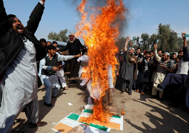 People chant slogans as they burn an effigy depicting Indian Prime Minister Narendra Modi, after Pakistan shot down two Indian military aircrafts, according to Pakistani officials, in Peshawar, Pakistan February 28, 2019