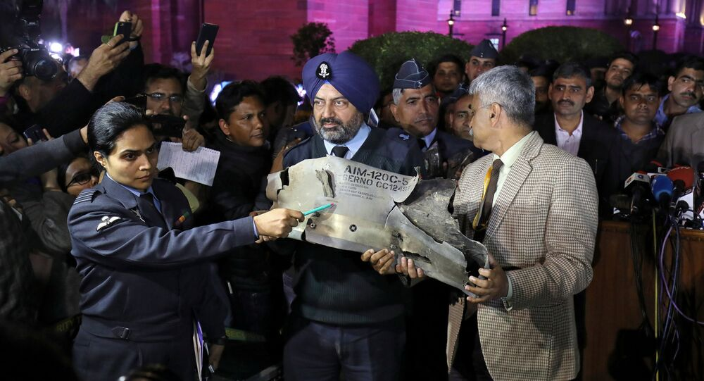 Indian Air Force officials display a wreckage of AMRAAM air-to-air missile that they say was fired by Pakistan Air Force fighter jet during a strike over Kashmir on Wednesday, after speaking with the media in the lawns of India's Defence Ministry in New Delhi, India, February 28, 2019