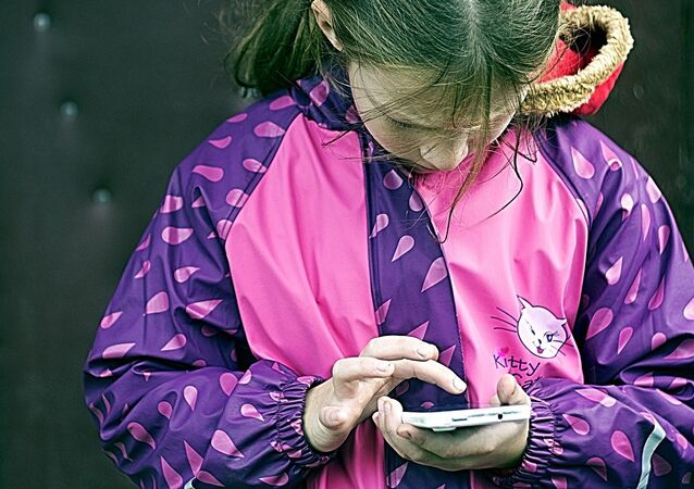 A girl using her mobile phone