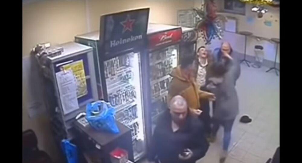Saleswoman 'calms down' violent customer.