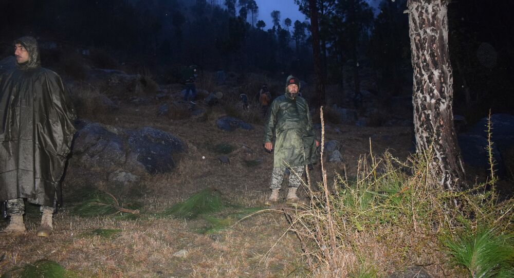 Pakistani soldiers and media personnel gather at the site where the Indian Air Force (IAF) strike launched on a Jaish-e-Mohammad (JeM) camp at Balakot on February 26, 2019