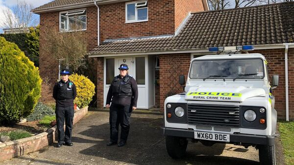 A police officer stands guard outside of the home of former Russian military intelligence officer Sergei Skripal, in Salisbury, Britain - Sputnik International