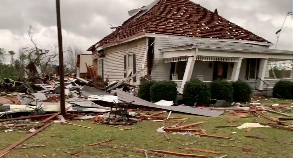 Debris and a Damaged House Seen Following a Tornado in Beauregard, Alabama