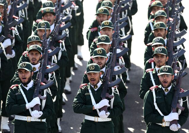 Members of the Iran's Revolutionary Guard march during an annual military parade marking the 34th anniversary of outset of the 1980-88 Iran-Iraq war, in front of the mausoleum of the late revolutionary founder Ayatollah Khomeini just outside Tehran, Iran, Monday, Sept. 22, 2014