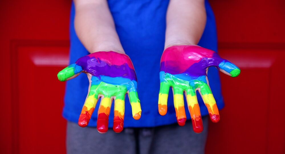 A child's hands covered in paint