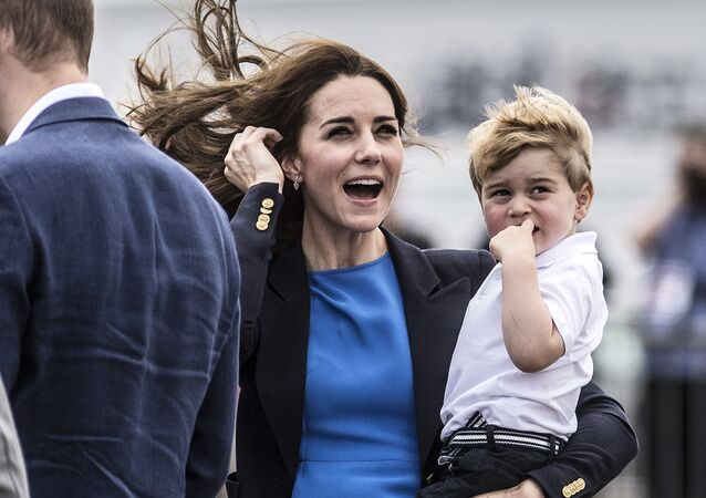 Kate, the Duchess of Cambridge, reacts to a low flying air display as she carries Prince George during a visit to the Royal International Air Tattoo at RAF Fairford in Gloucestershire, England, Friday July 8, 2016