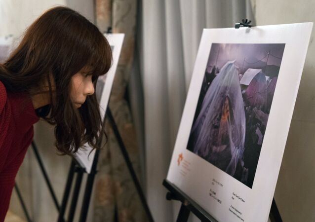 An exhibition of photos by winners of the Andrei Stenin International Press Photo Contest opened in Tokyo