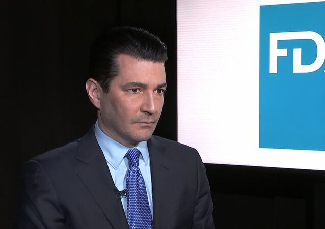 Food and Drug Administration Commissioner Scott Gottlieb listens during an interview with The Associated Press in New York on Monday, March 5, 2018.