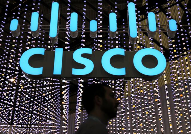 A man passes under a Cisco logo at the Mobile World Congress in Barcelona, Spain February 25, 2019