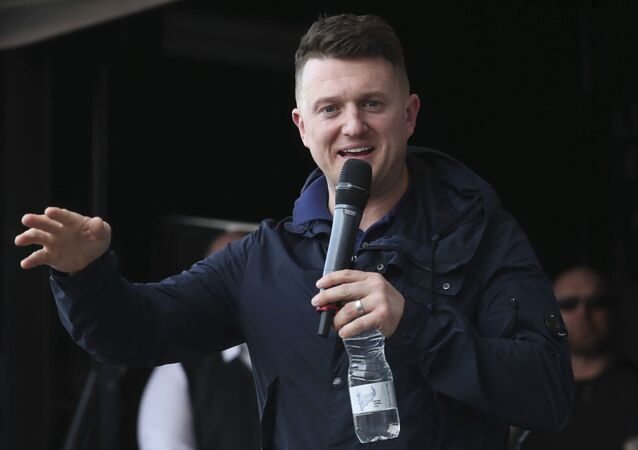 Former leader and founder of the English Defence League, Tommy Robinson addresses an EDL protest over a TV program, outside the BBC building in Salford, England, Saturday Feb. 23, 2019