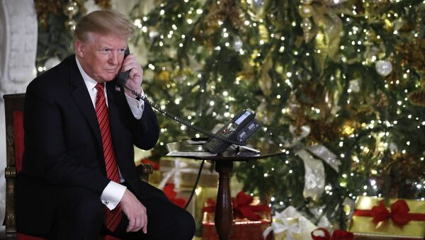President Donald Trump listens on the phone as he shares updates to track Santa's movements from the North American Aerospace Defense Command (NORAD) Santa Tracker on Christmas Eve, Monday, Dec. 24, 2018 - Sputnik International