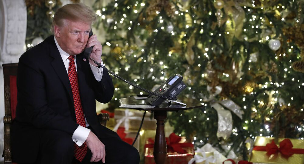 President Donald Trump listens on the phone as he shares updates to track Santa's movements from the North American Aerospace Defense Command (NORAD) Santa Tracker on Christmas Eve, Monday, Dec. 24, 2018