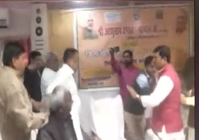 BJP MP Sharad Tripathi thrashes BJP MLA Rakesh Singh with shoe