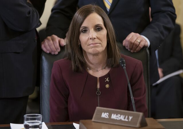 Before a hearing by the Senate Armed Services Subcommittee on Personnel about prevention and response to sexual assault in the military, Sen. Martha McSally, R-Ariz., prepares to recount her own experience while serving as a colonel in the Air Force, on Capitol Hill in Washington, Wednesday, March 6, 2019. McSally, the first female fighter pilot to fly in combat, says she was raped in the Air Force by superior officer