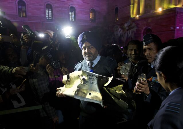 Defense officials display a part of an air-to-air AMRAAM missile which was allegedly fired by Pakistani Air Force aircraft violating Indian airspace, in New Delhi, India, Thursday, Feb. 28, 2019