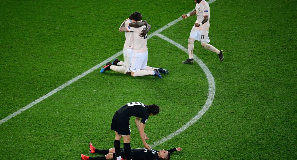 Brazilian midfielder Fred runs to join celebrating Manchester United players Romelu Lukaku and Andreas Pereira as PSG players collapse in despair