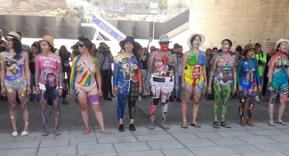 Naked body paint protesters in Santiago