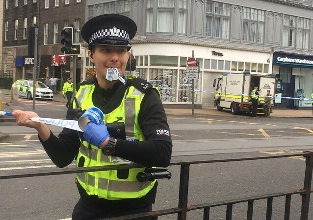 A police officer cordoning off a section of Prince's Street in Edinburgh.