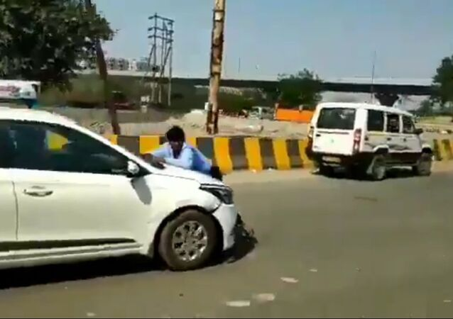 Man Atop Moving Car in Road Rage Incident in India