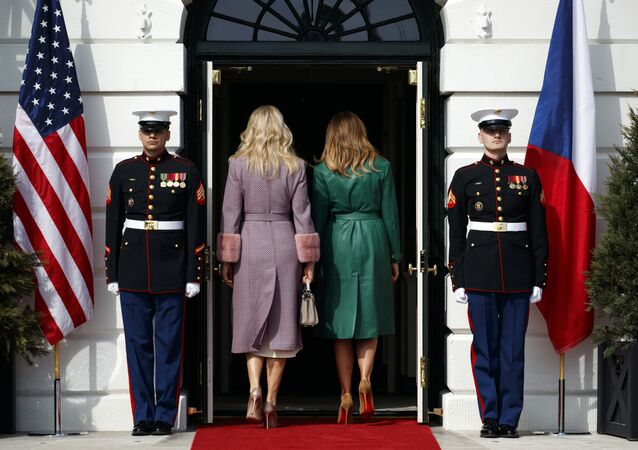 Monika Babisova, wife of Czech Prime Minister Andrej Babis, left, and first lady Melania Trump walk into the White House, Thursday, March 7, 2019, in Washington