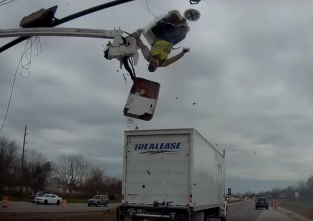 Worker Turned Upside Down as Truck Clips Cherry Picker